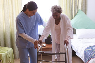 female caregiver assisting senior woman